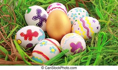 Colorful Easter eggs on grass Rotation