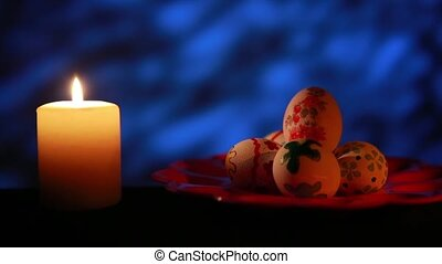 Easter candle with ornaments in the dark