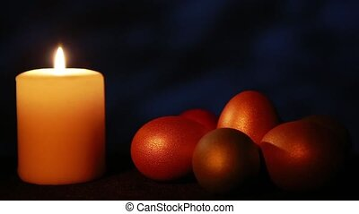 Easter candle with ornaments in the dark background