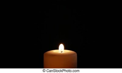 Candle goes on black background