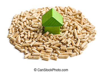 Concept of ecological and economic heating. Wooden pellets.