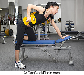 young girl in the gym for sports - young girl goes in for...
