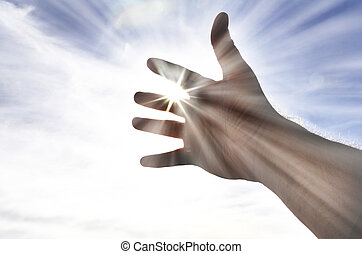 Persons Hand Reaching Towards Heaven Sunlight - Persons hand...