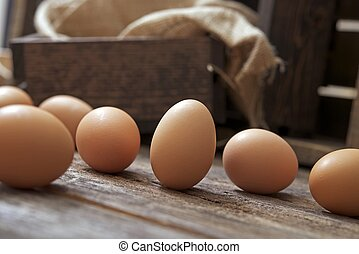 Organic Eggs on Wood - Organic Eggs on Aged Wood Table.