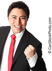 Yeah! - Businessman with a raised fist, wearing a suit and...