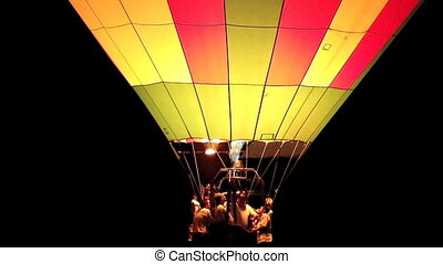 Hot Air Balloon Glowing - Hot air balloon lights up for an...