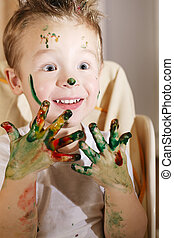 Cute excited boy with hands full of finger paint - Cute...