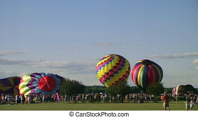 Hot Air Balloon Lift-Off - Hot air balloons rise to the sky...