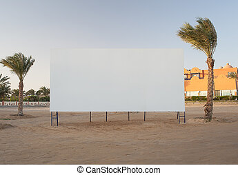 Blank billboard with palm trees - Blank white billboard with...