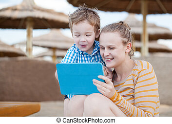 Happy mother and son at a beach resort - Happy mother and...