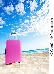 Pink baggage on the beach - Pink suitcase bag on the sand on...
