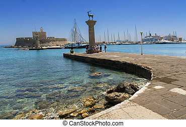 Rhodes Mandraki harbor with castle and symbolic deer...