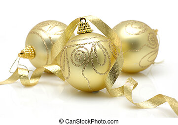 Golden christmas balls with ribbon in isolated white...