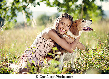 Teenage girl with dog - Portrait of a teenage girl with her...