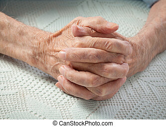 Care is at home of elderly. Old people holding hands....
