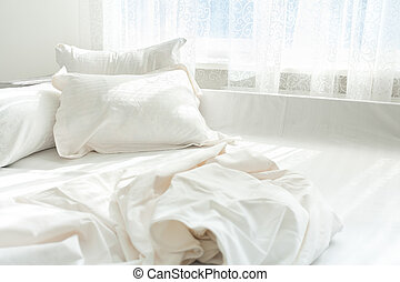untidy bed against window - Photo of untidy bed against...