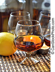 Brandy and lemon - a glass of brandy, candles and lemon
