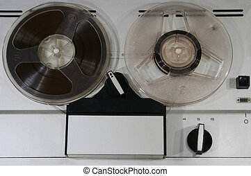 bobbins - obverse board of obsolete tape recorder with two...
