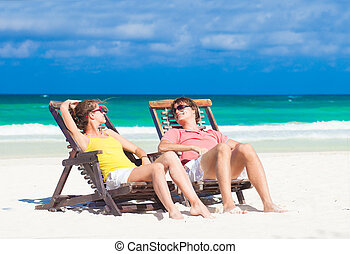 Happy Romantic Couple Enjoying the Sun at the Beach Looking...