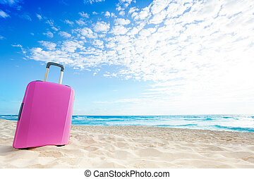 Pink baggage on the sand - Pink women baggage bag on the...