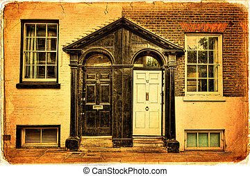 Greenwich - Entrance of a house with two doors, one white...