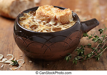 French onion soup on rustic wooden table