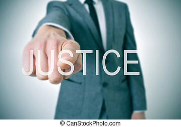 justice - man wearing a suit pointing the finger to the word...