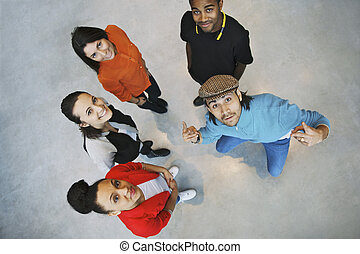 Multiethnic young people looking happy - Overhead view of...