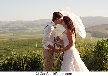 African bride and groom landscape - Bride and groom outside...