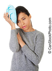 Woman having headache - Woman with ice bag, having headache...