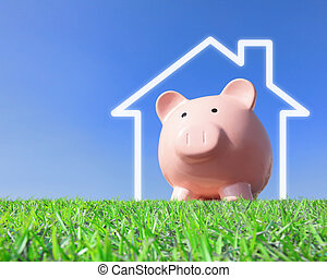Dreaming a home - A pink piggy bank with new home house...