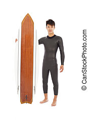 surfer man standing and holding a surfboard
