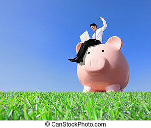 Happy Saving Money with my piggy bank - Young business man...