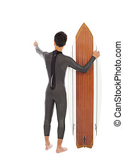 surfer man holding a surfboard and point somewhere