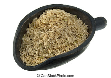 scoop of long grain brown rice - long grain brown rice on a...