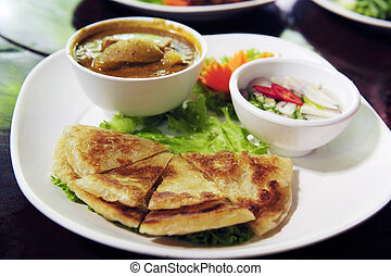 Chicken curry with Roti - Crispy Roti Bread with chicken...