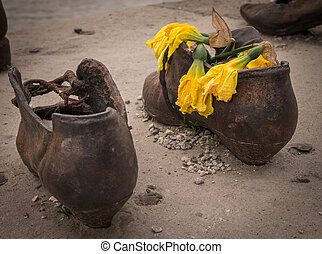 Withered flowers - The Shoes on the Danube Promenade is a...