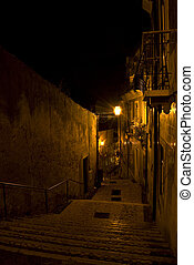 Alfama - old steps leading through the old quarter Alfama in...