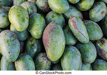 Mangoes. - Close up group of mangoes for sale at the market...