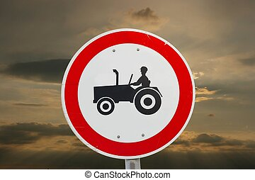 Tractors not allowed traffic sign against dramatic sky