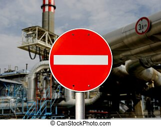 No entry traffic sign in front of an industrial area