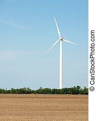 Wind power station on an open field