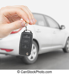 Male holding car keys with remote control system - 1 to 1...