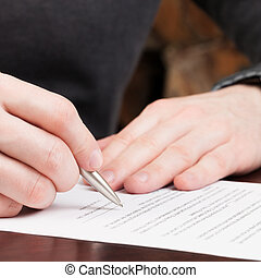 Business men reading contract - 1 to 1 ratio - Financial...