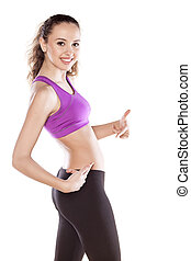 sporty girl - happy sporty girl showing her belly and thumbs...