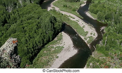Siberian River - View of the flow of the river from a high...