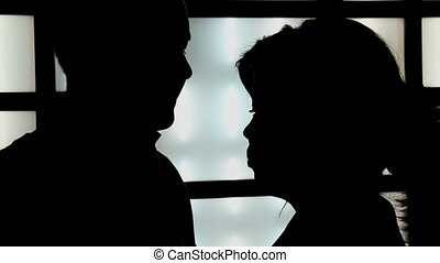 Silhouettes of Lovers - Silhouette couple on the background...