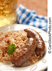 grilled bavarian sausages with sauerkraut and beer