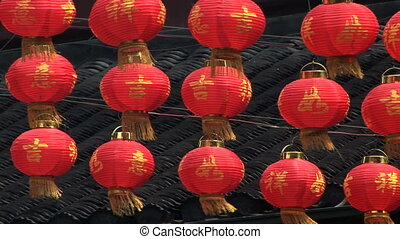 Paper Lanterns - Chinese red paper lantern swaying in the...
