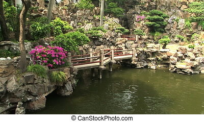 Chinese Bridge - Foot bridge over a pond at the Yuyuan...